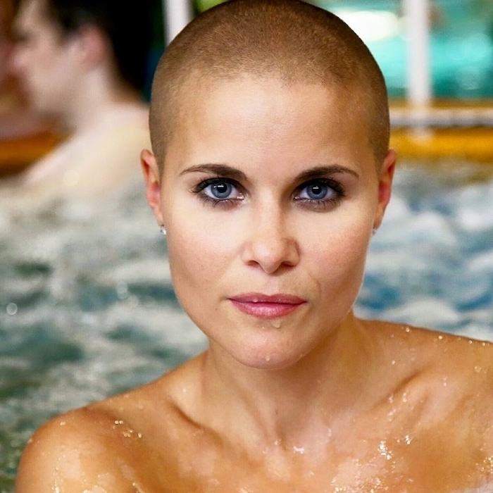 buzz cut, woman in water, with blue eyes, short to medium hairstyles