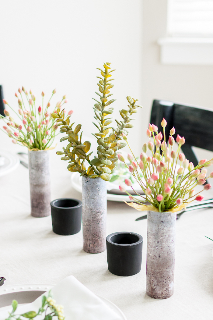 table decoration ideas, cement vases, bouquet of succulents, bouquets of flowers, black candle holders