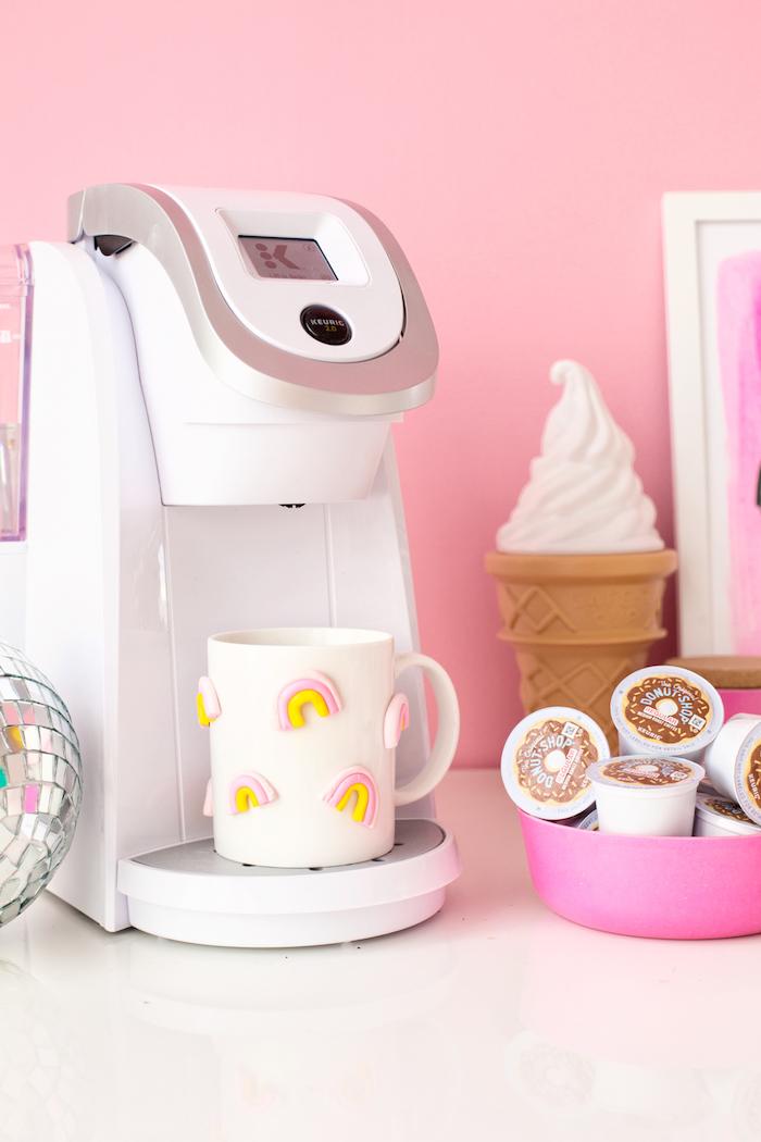 homemade christmas gifts for adults, white coffee machine, white coffee mug, rainbow figurines glued to it