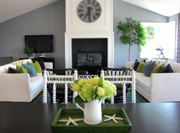 best color for living room walls, a shaped ceiling, white sofas, green and blue, throw pillows, grey walls