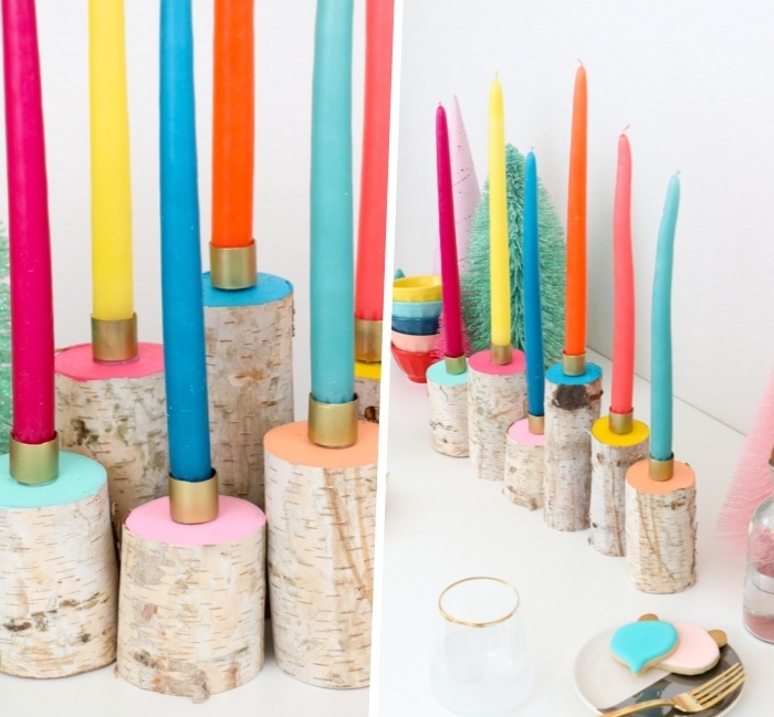 colourful candles, on top of round blocks of wood, table centerpieces, painted in different colours