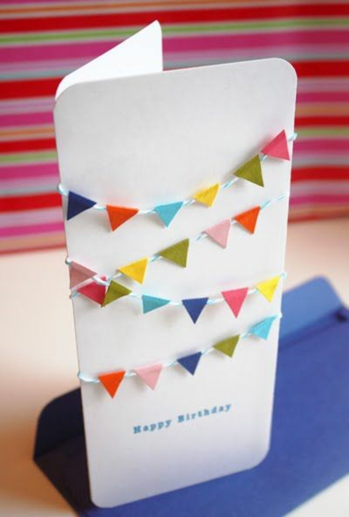 white card stock, colourful garland across, colourful background, birthday card design