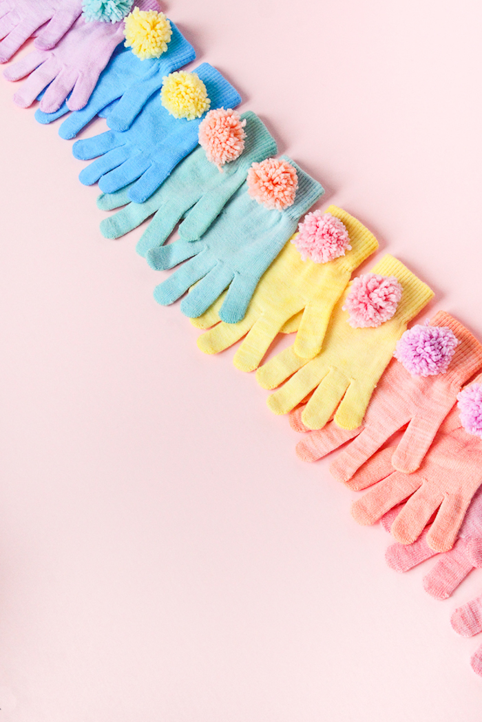 colourful gloves, decorated with colourful pom poms, cute gifts for boyfriend, pink background
