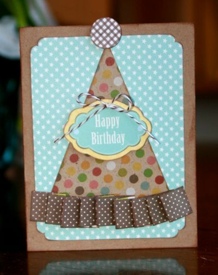 birthday card design, colourful party hat, brown ribbon, blue card stock, white stars on it