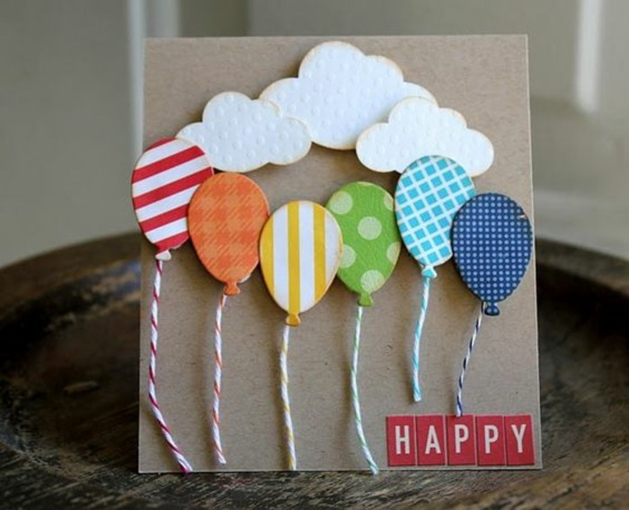 colourful patterned balloons, white clouds, funny things to write in a birthday card, wooden table