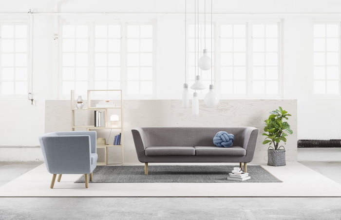 grey sofa, blue armchair, room design ideas, grey rug, small wooden bookshelf, white walls