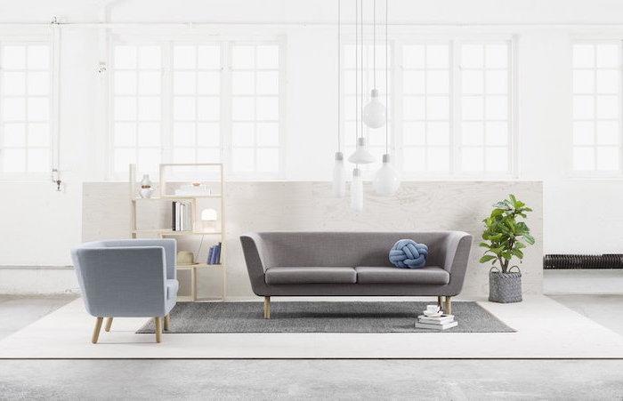 grey sofa, blue armchair, room design ideas, grey rug, small wooden bookshelf, white walls