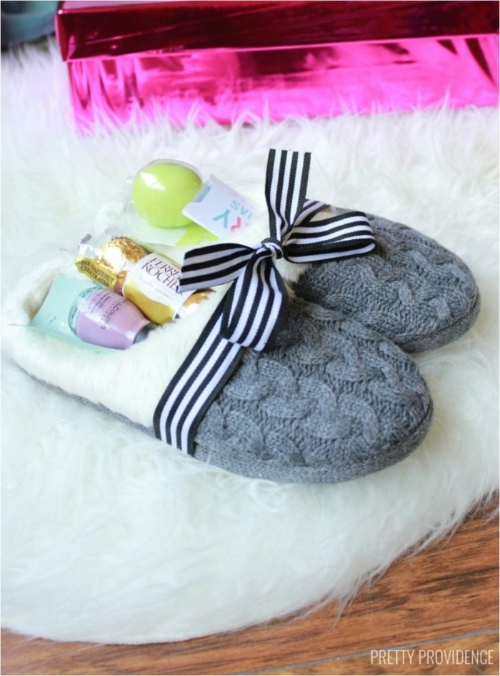 grey knitted slippers, filled with ferrero rocher candy, purple nail polish, eos lip balm, diy gifts for friends
