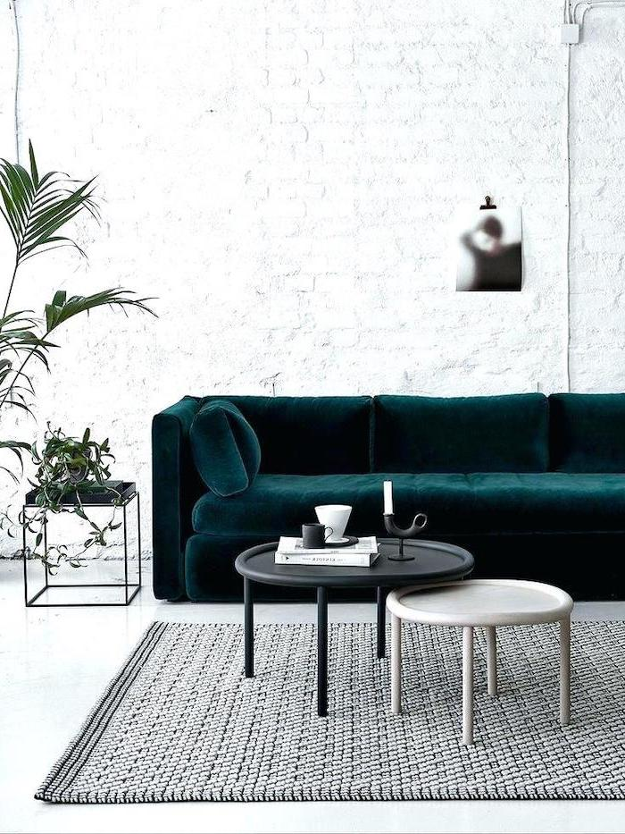 blue velvet sofa, grey rug, white brick wall, metal coffee tables, small living room ideas