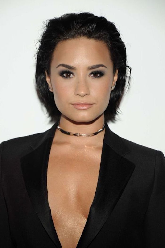 demi lovato, wearing a black blazer, short haircuts for women, black hair, white background