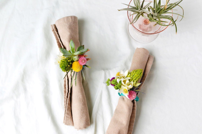 beige cotton napkin, table decoration ideas, floral napkin rings, small glass, tree branches inside