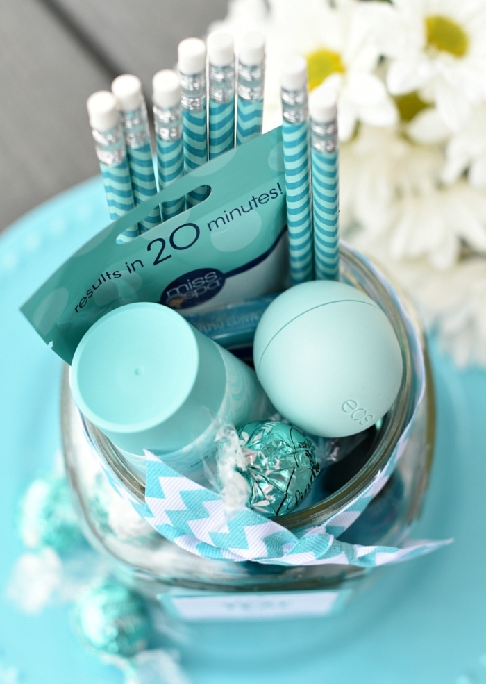 turquoise pencils, eos lip balm, diy gifts for friends, lindt chocolate candies, bouquet of daisies