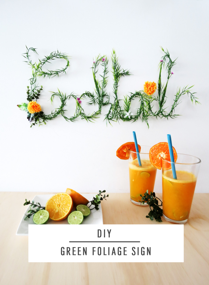 diy green foliage sign, living room wall decor ideas, two glasses, of orange juice, on a wooden table