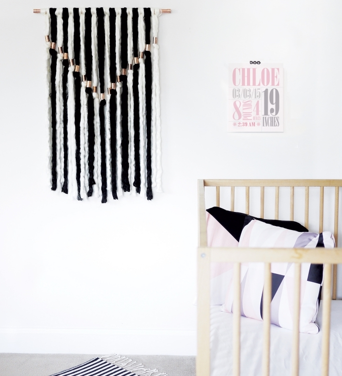 black and white macrame, wall art, hanging over a baby crib, white wall decor, colourful throw pillows
