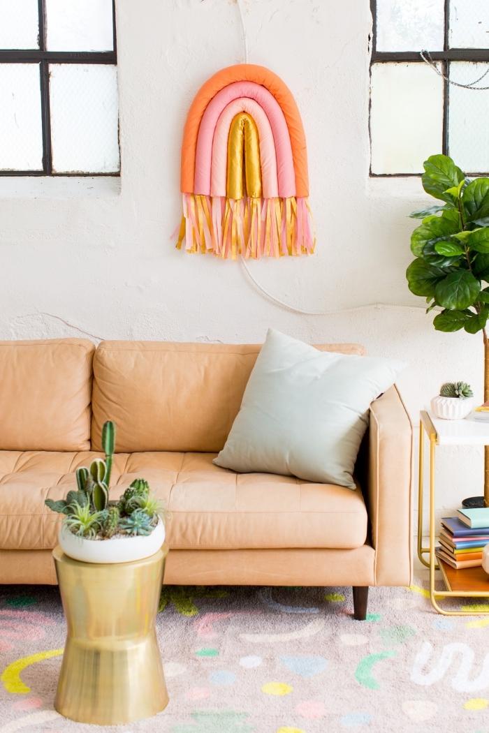 diy rainbow wall art, large wall decor, orange sofa, light blue throw pillow, colourful carpet