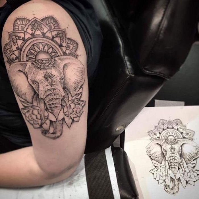 elephant shoulder tattoo, black leather armchair, lotus mandala tattoo, black and white sketch, in the background