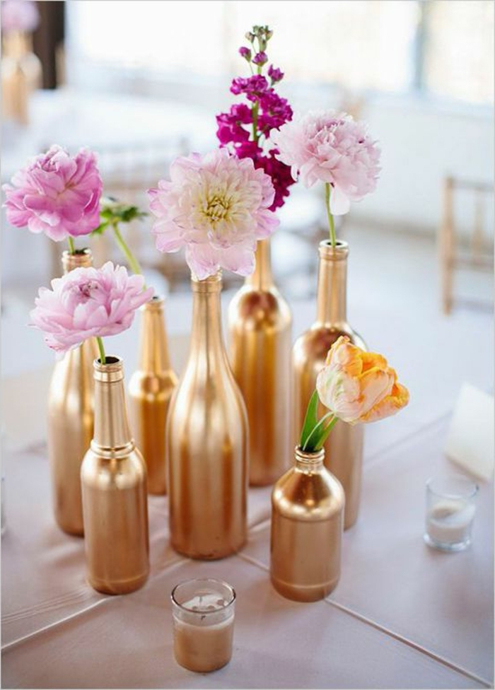 glass bottles, painted in gold, spring flower in each one, dining table centerpiece ideas, small candles
