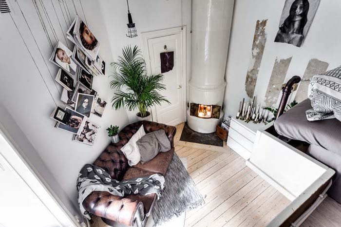 brown leather couch, wooden floor, room design ideas, two level studio apartment, hanging photos