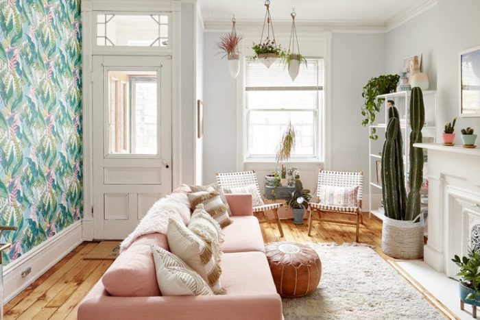 floral wallpaper, accent wall, pink sofa, leather ottoman, room design ideas, wooden floor