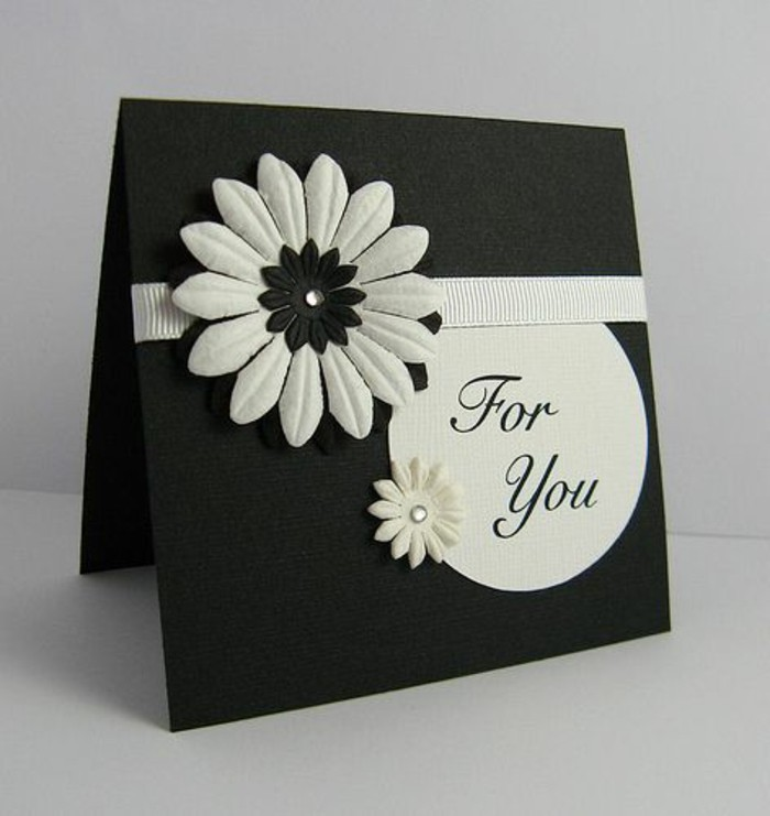 black card stock, white flowers, white ribbon, how to make a birthday card, white background