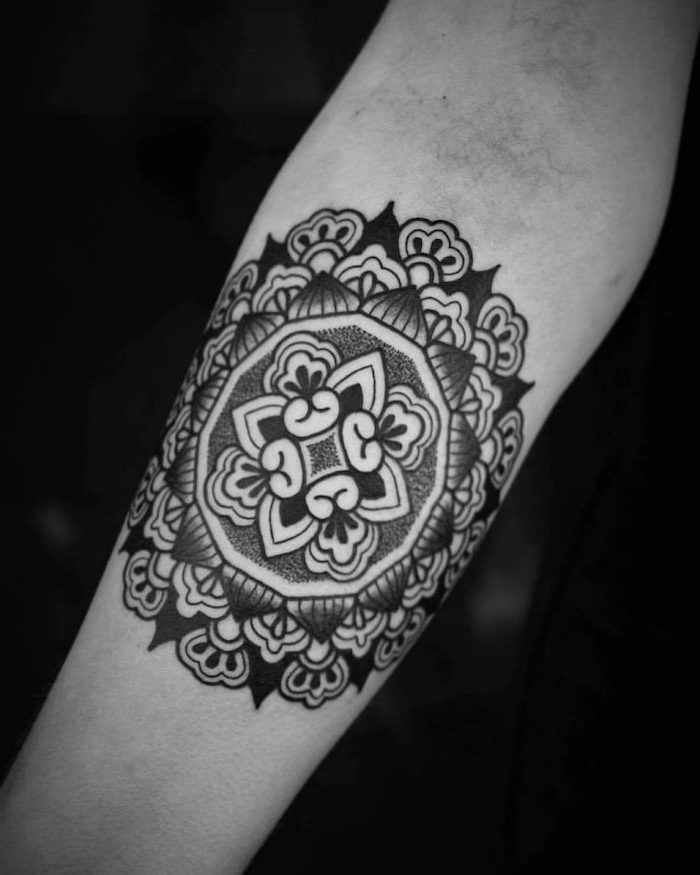 lotus mandala tattoo, black background, forearm tattoo