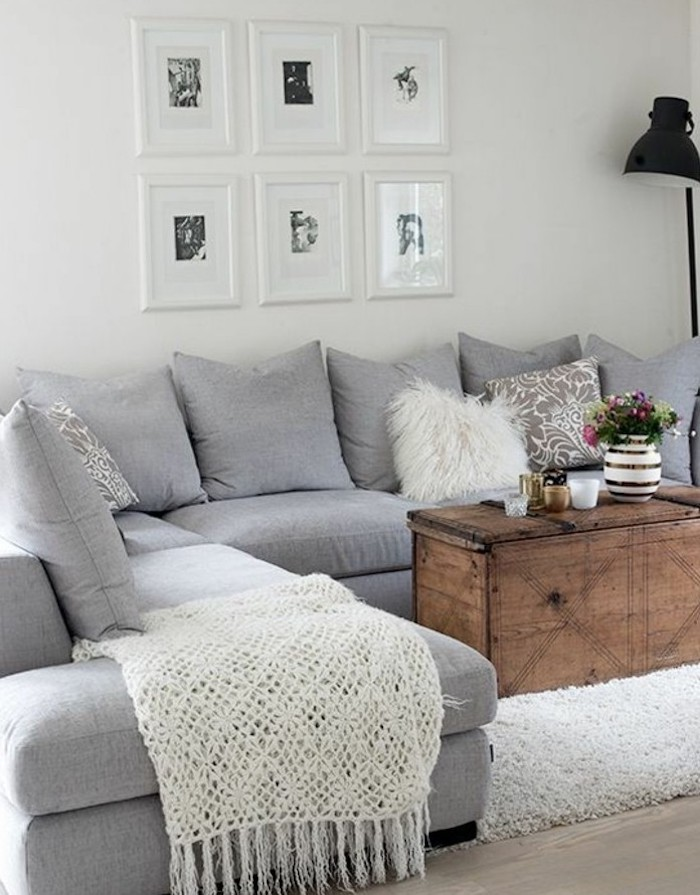 vintage wooden coffee table, grey corner sofa, what colors match with grey, white blanket, framed hanging art