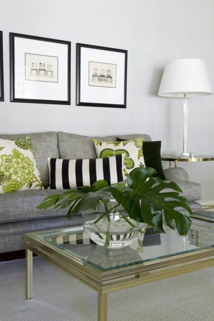 glass coffee table, grey sofa, green floral, throw pillows, what colors match with grey, framed hanging art