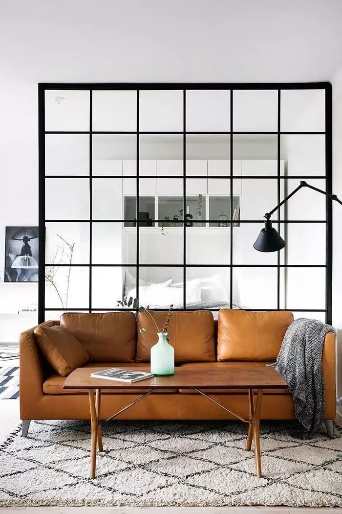 glass divider, brown leather couch, living room furniture for small spaces, white and grey carpet