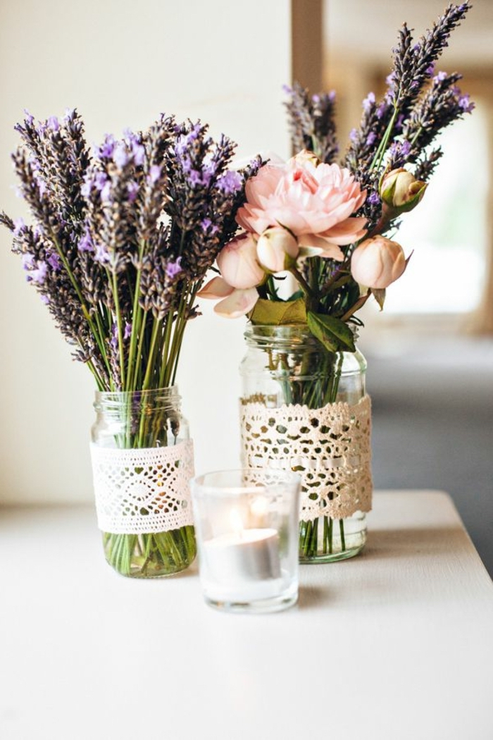 two glass jars, lavender bouquet, flowers and lavender bouquet, kitchen table decor, wooden table