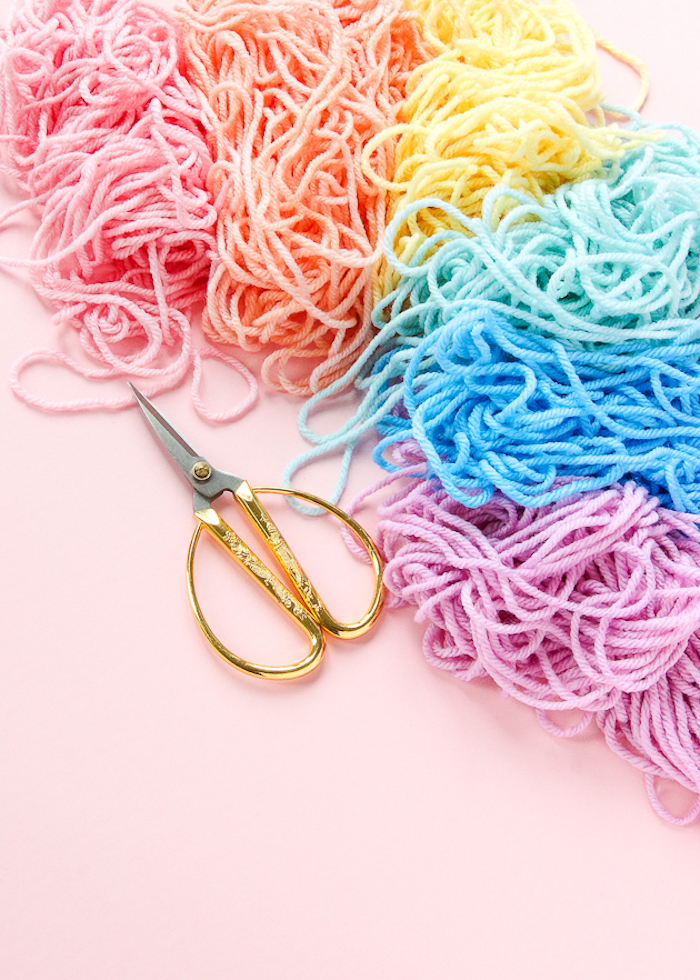 colourful yarn, pink background, cute gifts for boyfriend, pair of scissors, step by step, diy tutorial