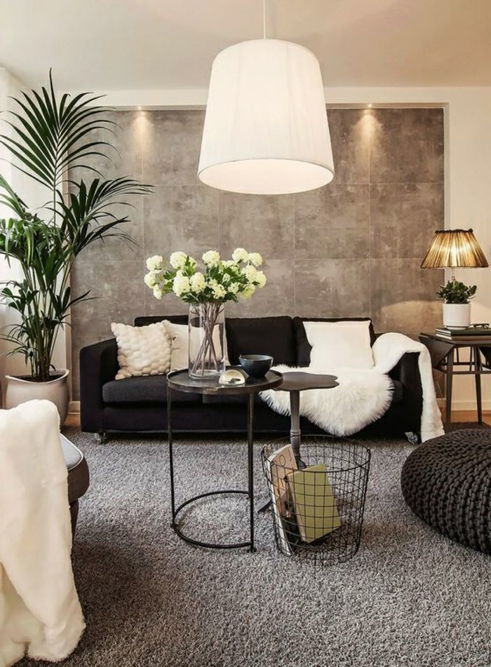 black sofa, white throw pillows, black ottoman, what colors match with grey, potted palm, metal black coffee table