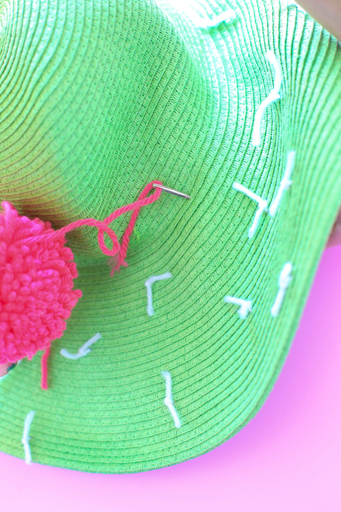 green hat, pink pom pom, pink and white yarn, diy anniversary gifts for him, pink background