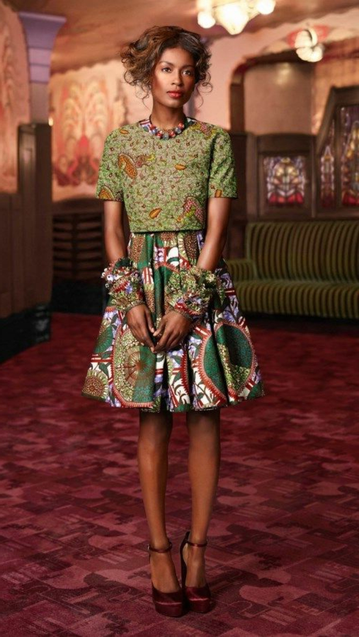 red carpet, woman wearing a skirt and a crop top, african dresses, brown hair in a low updo