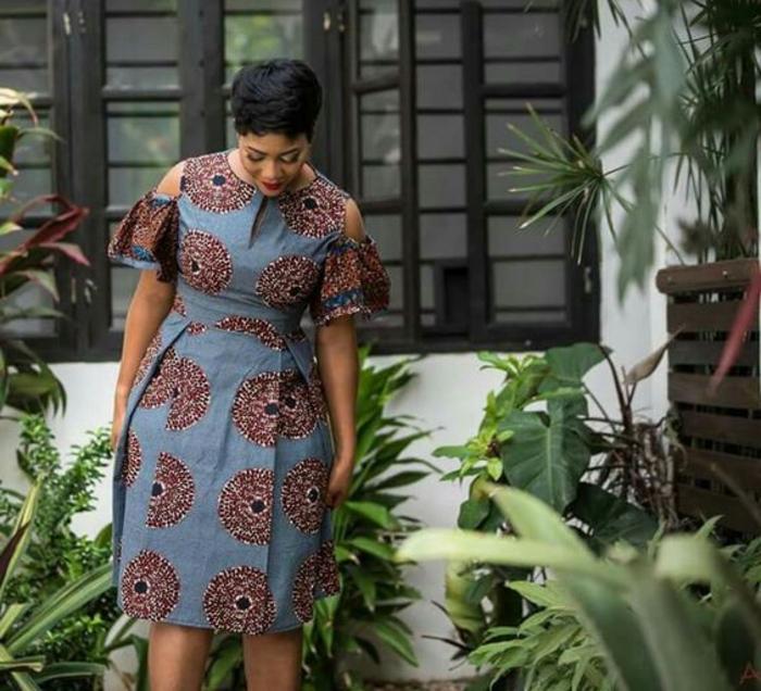 african attire for women, short dress, short black hair, lots of greenery around
