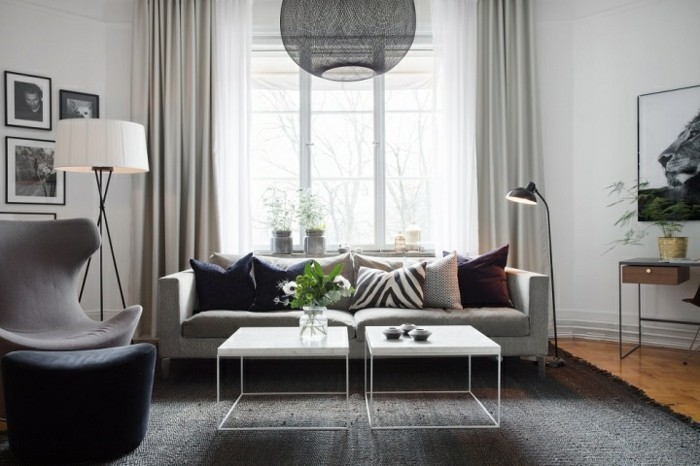 grey carpet, grey sofa and armchair, gray and white living room, white metal coffee tables
