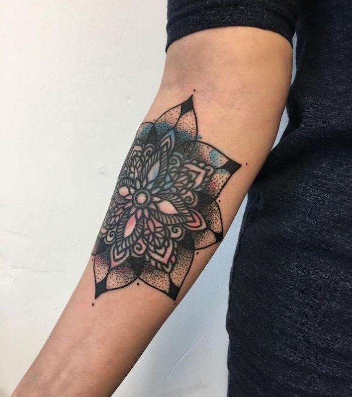 colourful forearm tattoo, white background, mandala symbols, grey top