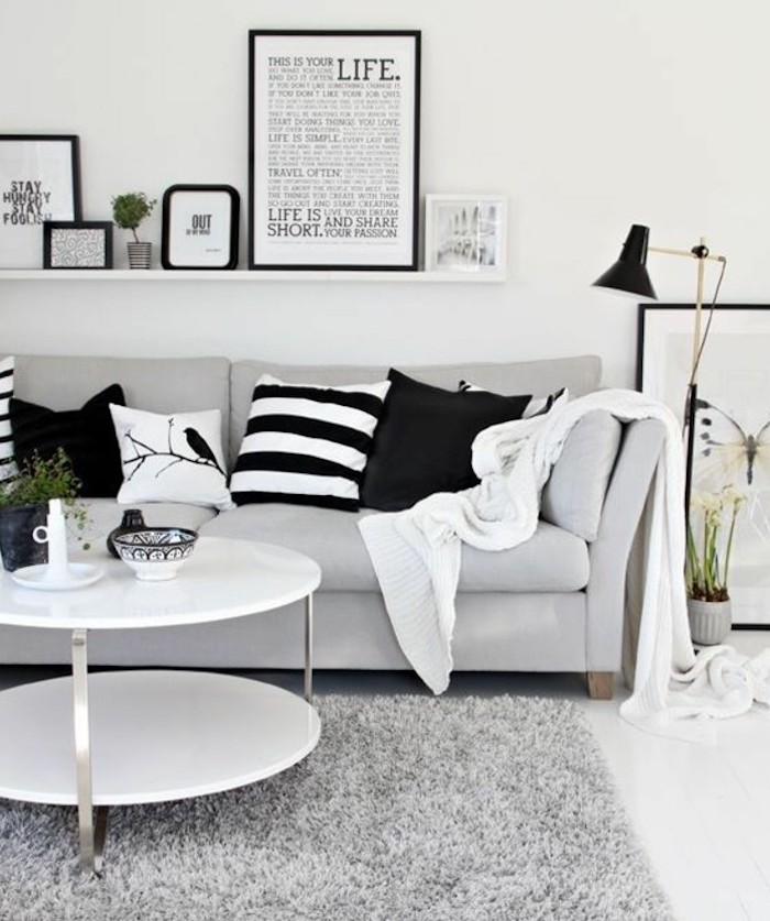 framed art,, on a hanging shelf, white coffee table, light grey sofa, what colors match with grey