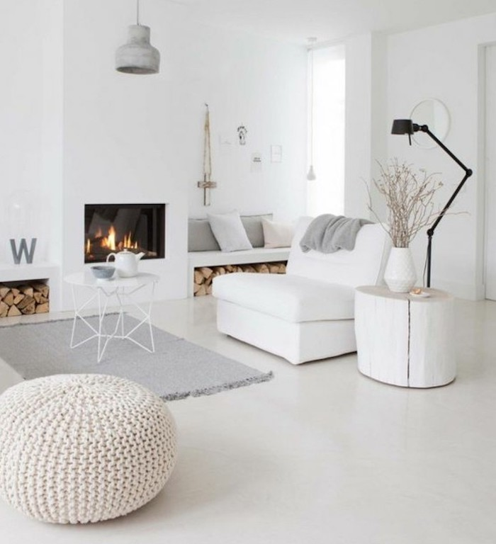 gray living room waves, white armchair and ottoman, grey rug, small white metal, coffee table, wooden side table