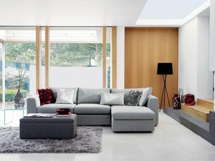 grey furry blanket, grey corner sofa, white tiled floor, gray living room walls, grey ottoman