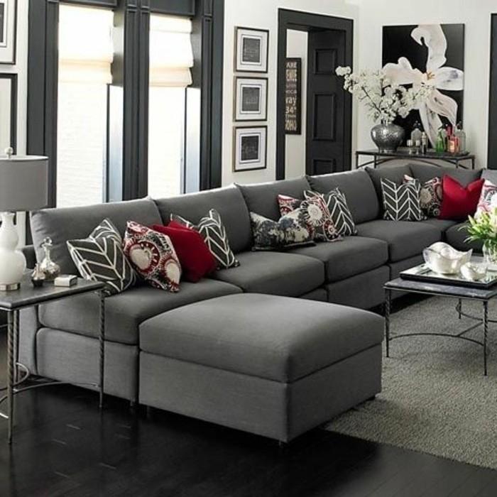 black door and window frames, black wooden floor, gray living room walls, grey corner sofa, metal coffee table