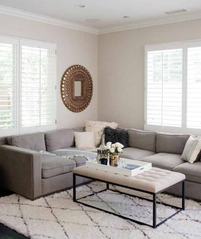 white leather coffee table, grey couch living room, white walls, white carpet, tray with vases