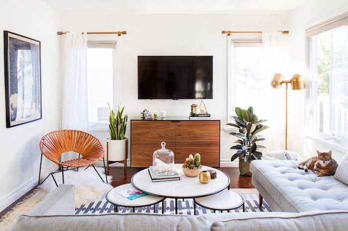 white corner sofa, white metal coffee tables, wooden cabinets, white curtains, living room furniture for small spaces