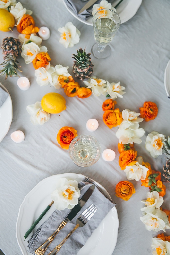 dining table decoration, white and orange flowers, table runner, grey cotton napkins, table setting