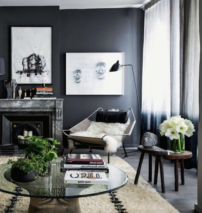 framed hanging art, above the fireplace, glass coffee table, dark grey walls, grey color schemes