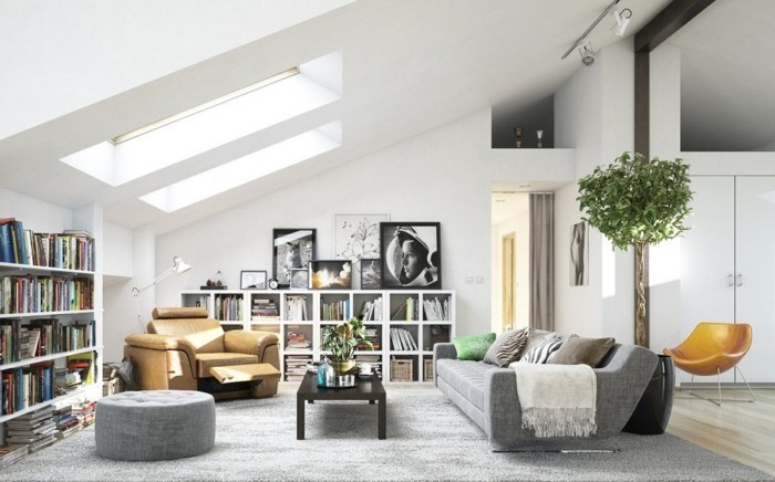 brown leather armchair, grey couch living room, grey ottoman, black wooden coffee table, large grey carpet