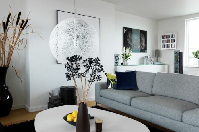 grey sofa, white walls, gray and white living room, white coffee table, black vase, wooden floor