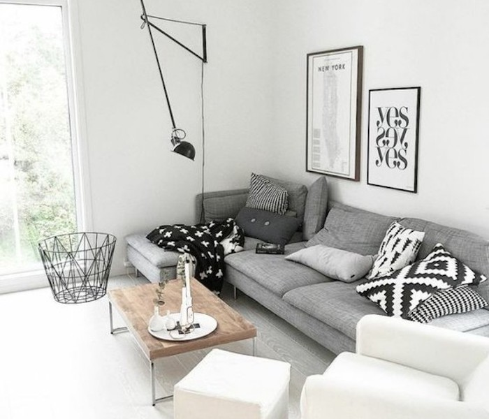 accent colors for gray, grey corner sofa, white armchair and ottoman, wooden coffee table, framed hanging art