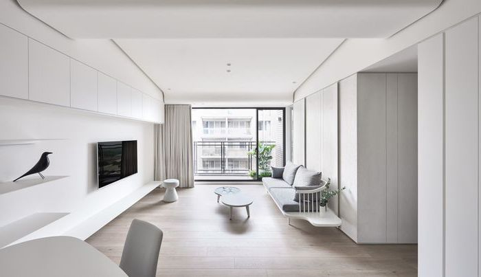 grey sofa, white walls, white metal coffee tables, living room furniture layout, beige curtains