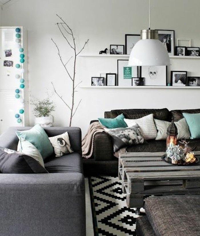grey and black sofas, turquoise throw pillows, wooden pallet coffee table, accent colors for gray