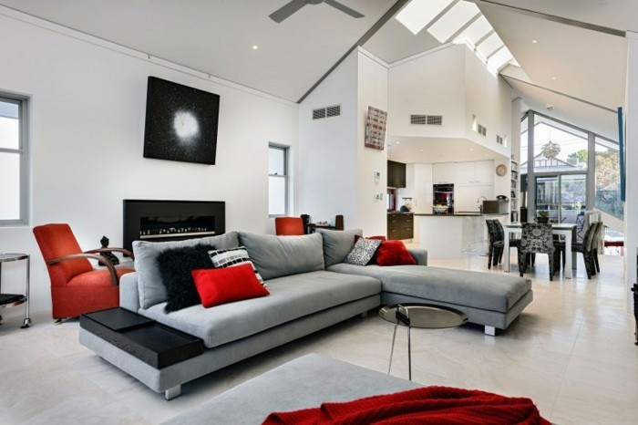 colors that go with gray walls, grey corner sofa, red throw pillows, a shaped ceiling, red armchair
